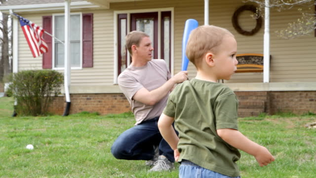Father and son play baseball video