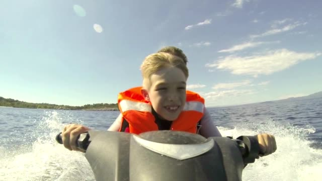 Father and son riding Jet-Ski video