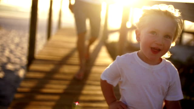 stockvideo's en b-roll-footage met father and son running on jetty - pier