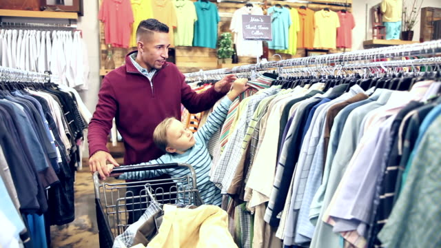 Father and son shopping for clothing video