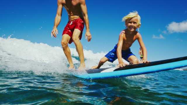 Father and Son Surfing video