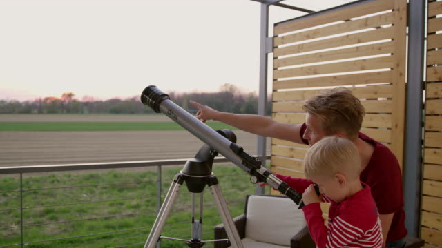 DS MS Father and son using a telescope video