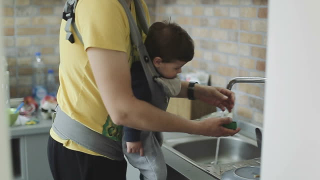 Father and son washing dishes in kitchen sink Father and son washing dishes in kitchen sink washing dishes stock videos & royalty-free footage