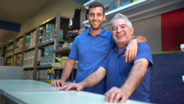 Father and son working together in a paint store Father and son working together in a paint store salesman stock videos & royalty-free footage