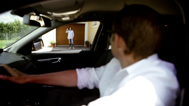 father brings son home to his mother in a car and waves good-bye - divorzio video stock e b–roll