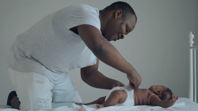 Father Changing Diaper on Baby