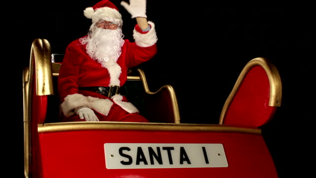 father christmas winkt aus dem schlitten - nikolaus stiefel stock-videos und b-roll-filmmaterial