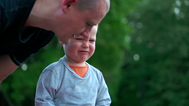 Father comforting crying boy video