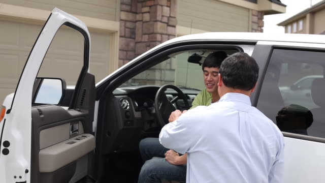 Father congratulates son as he gets into new truck video