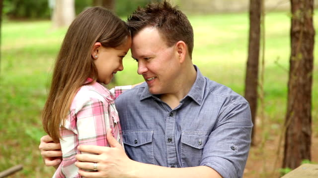 Father, daughter hugging outdoors. Parent, child. Love, affection. video