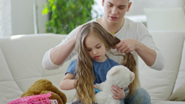 Father Doing Daughters Hair video