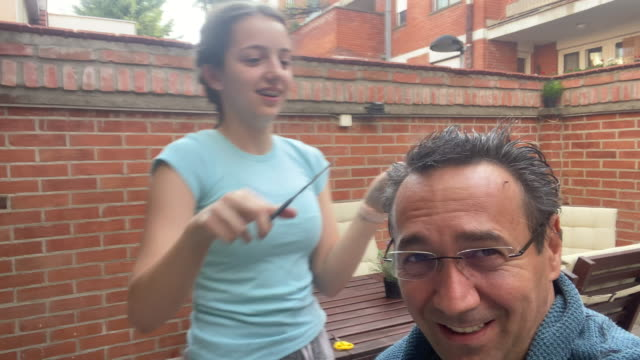 Father Getting A Haircut From Daughter At Home During Coronavirus Quarantine Father getting a haircut from daughter at home during coronavirus quarantine. hairstyle stock videos & royalty-free footage