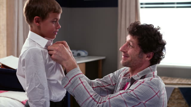 Father Getting Son Dressed Ready For School video