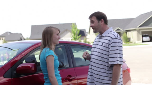 Father gives car keys to daughter  car key stock videos & royalty-free footage