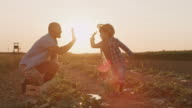 istock SLO MO Father gives his son a high five for a job well done in the field 1255769132