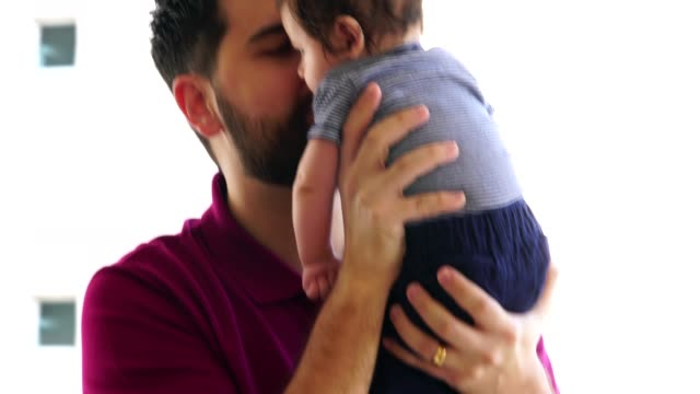 father holding newborn baby son at home - fathers day stock videos and b-roll footage