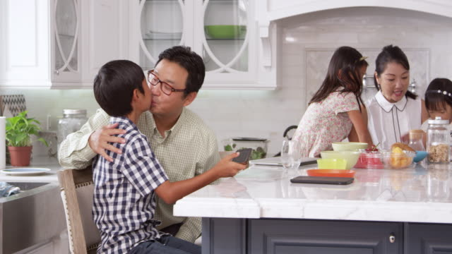 Father Leaving For Work After Family Breakfast Shot On R3D video