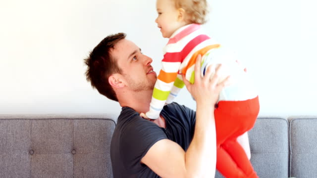 father playing with his son in living room 4k - 2 3 anni video stock e b–roll
