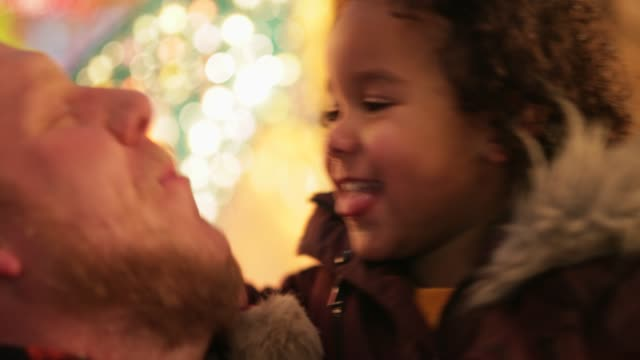 father playing with mischievous daughter - fare la lingua video stock e b–roll