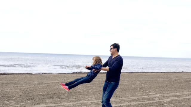 Father Spinning Daughter on a Sandy Shore of Lake Ontario video