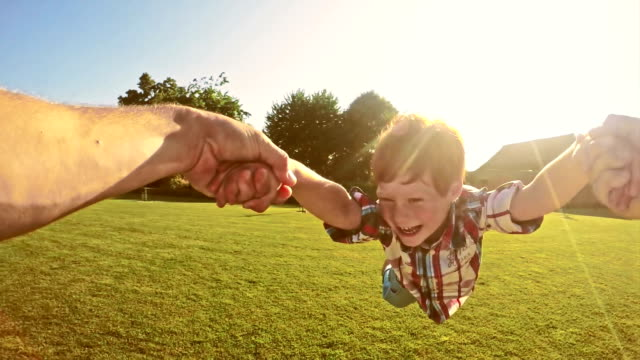 slo mo father spinning his son around - backyard stock videos & royalty-free footage