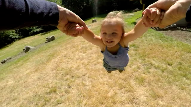 Father Swinging Daughter Around by Her Arms video