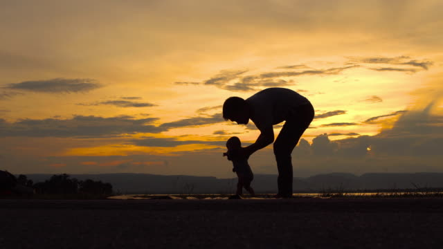 Father Teaching A Baby To Walk video