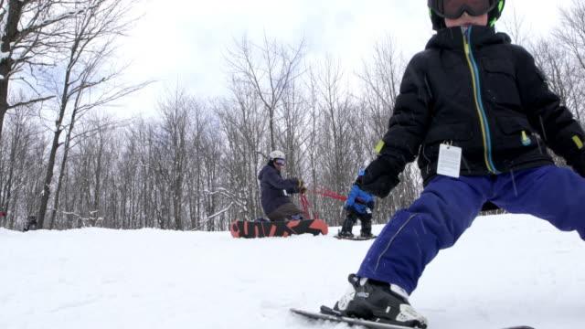 father Teaching Baby Son Ski Resort Weekend Amateur Winter Sport