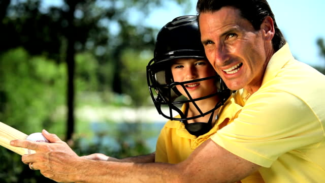 Father teaching his son baseball skills video