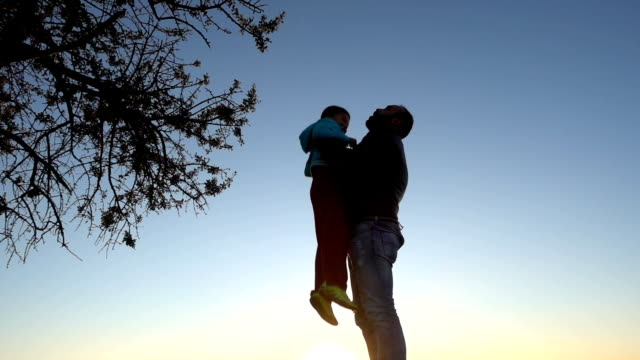 Father tossing son into air video