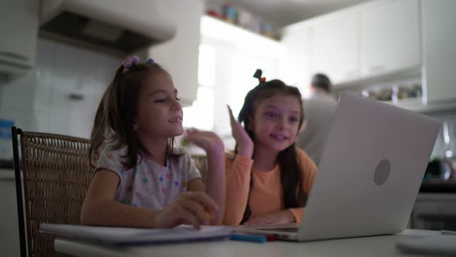Father watching videoclass with daughters at home video