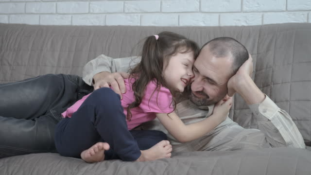 father with a child on the couch - eastern european descent stock videos & royalty-free footage