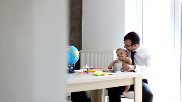 Father With Baby Working In Office At Home video
