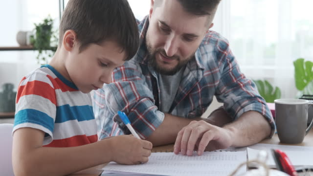 Father with child doing homework video