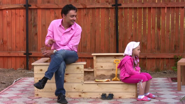 Father with little girl outdoor video