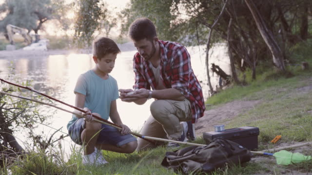 Father with son at fishing video
