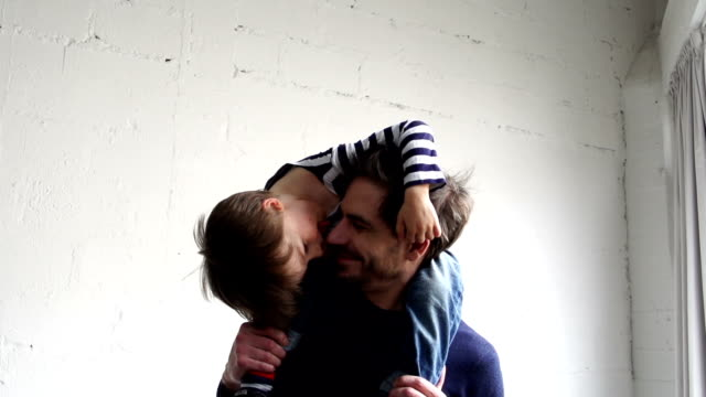Father with son on his shoulders - Slow motion video