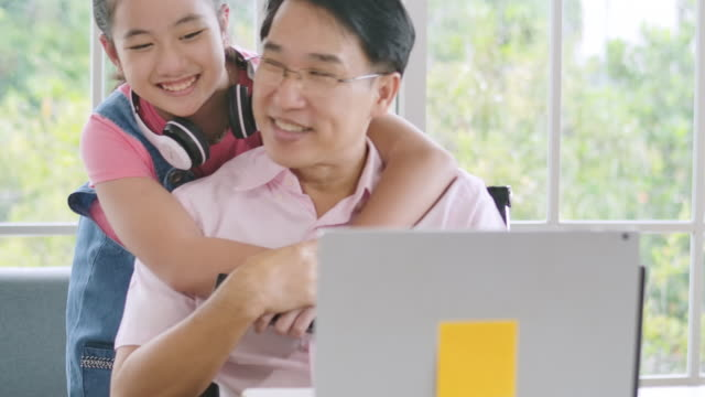 Father working from home with daughter Father working from home with daughter life balance stock videos & royalty-free footage