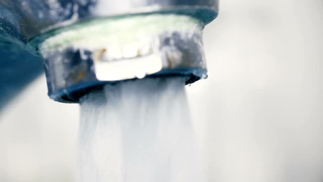 Faucet flushing water video