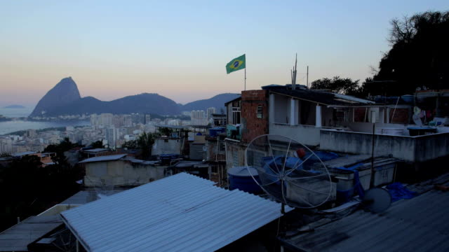 Favela Aerials -Flying over Brazil flag by Sugarloaf Mountain video