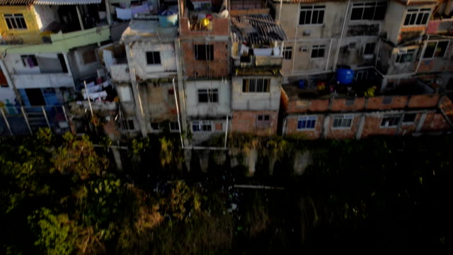 Favela Aerials: Rising past houses at sunrise on mountain, Rio de Janeiro, Brazil