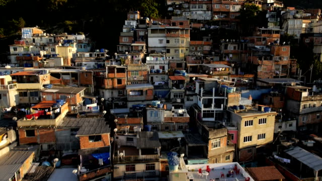 Favela Aerials: Slow move up favela mountainside houses in Rio de Janeiro, Brazil