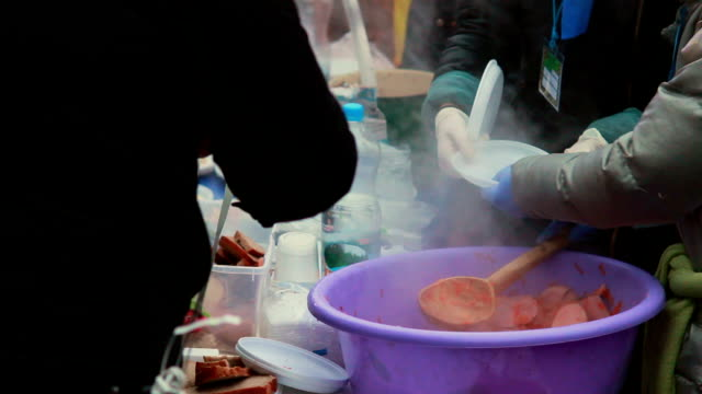 Feeding poor people outdoors blistering cold, hot meal winter Feeding poor people outdoors blistering cold, hot meal winter homeless person stock videos & royalty-free footage