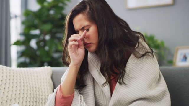 I feel terrible 4k video footage of a young woman sick with flu at home pollen stock videos & royalty-free footage