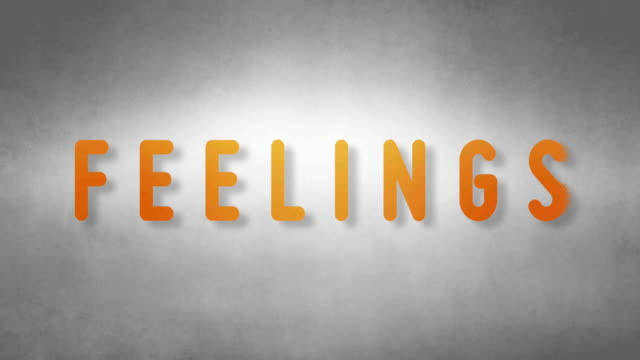 Feelings headband. Text from sand. With black background video