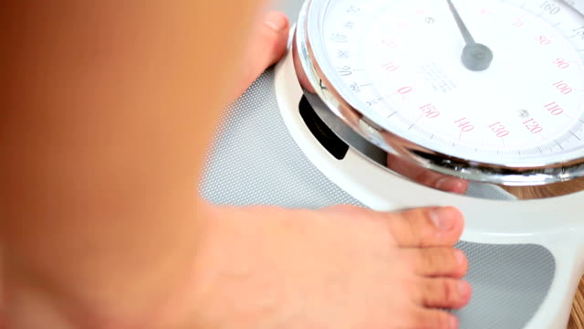 Feet in Close-up on Weighing Scales video