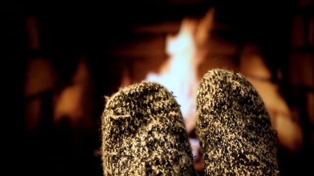 Feet in woollen socks by the fireplace Feet in woollen socks by the fireplace. sock stock videos & royalty-free footage
