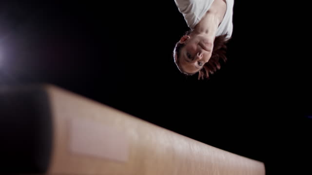 SLO MO Feet of a female gymnast doing a balance beam flip video