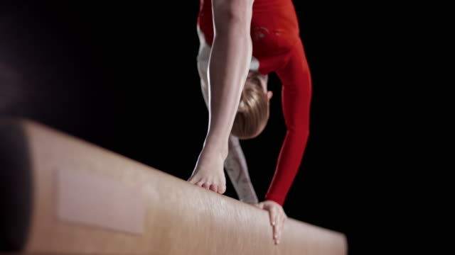 SLO MO Feet of a female gymnast while doing a back walkover