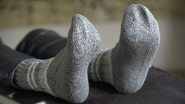 Feet Of A Relaxing Woman Moving To Music (4K/UHD) video